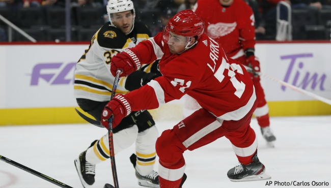 Detroit Red Wings center Dylan Larkin (71) shoots during the second period of an NHL hockey game against the Boston Bruins, Friday, Nov. 8, 2019, in Detroit. (AP Photo/Carlos Osorio)