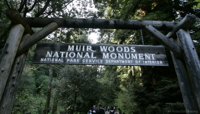 In this March 25, 2008 file photo visitors walk along a pathway near the entrance to the Muir Woods National Monument in Marin County, Calif. (AP Photo/Eric Risberg, File)