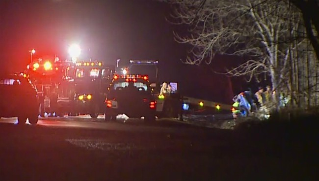 Authorities on scene of a deadly crash in Olive Township Friday, Dec. 13, 2019.