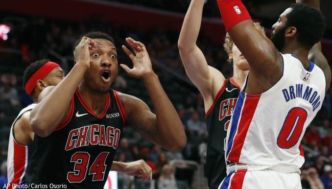 Chicago Bulls center Wendell Carter Jr. (34) reacts after being called for a foul against Detroit Pistons center Andre Drummond during the first half of an NBA basketball game, Saturday, Dec. 21, 2019, in Detroit. (AP Photo/Carlos Osorio)