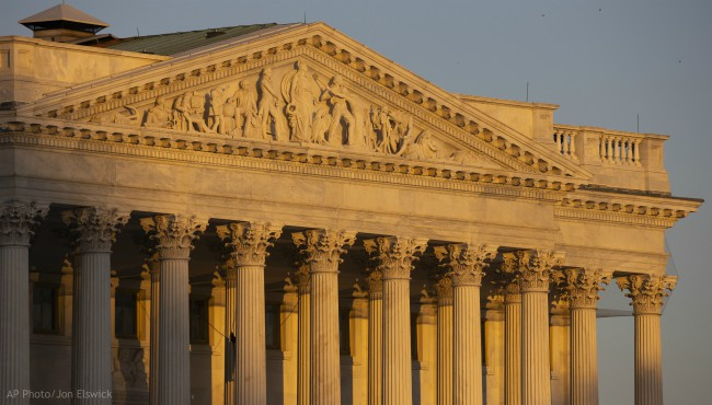 The Senate side of the U.S. Capitol at sunrise on Monday, Jan. 20, 2020, in Washington. (AP Photo/Jon Elswick)