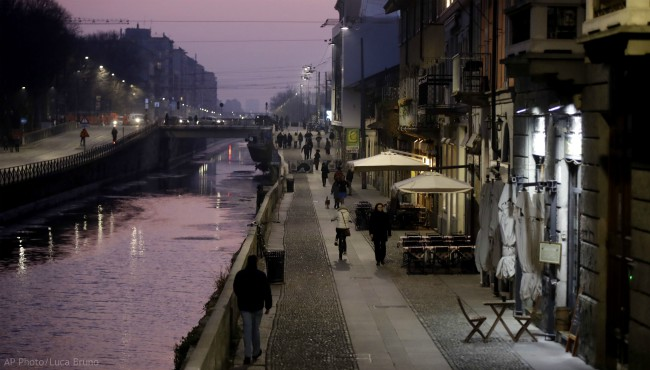 Empty bars and pubs at the Naviglio Grande canal in Milan, Italy, Monday, Feb. 24, 2020.