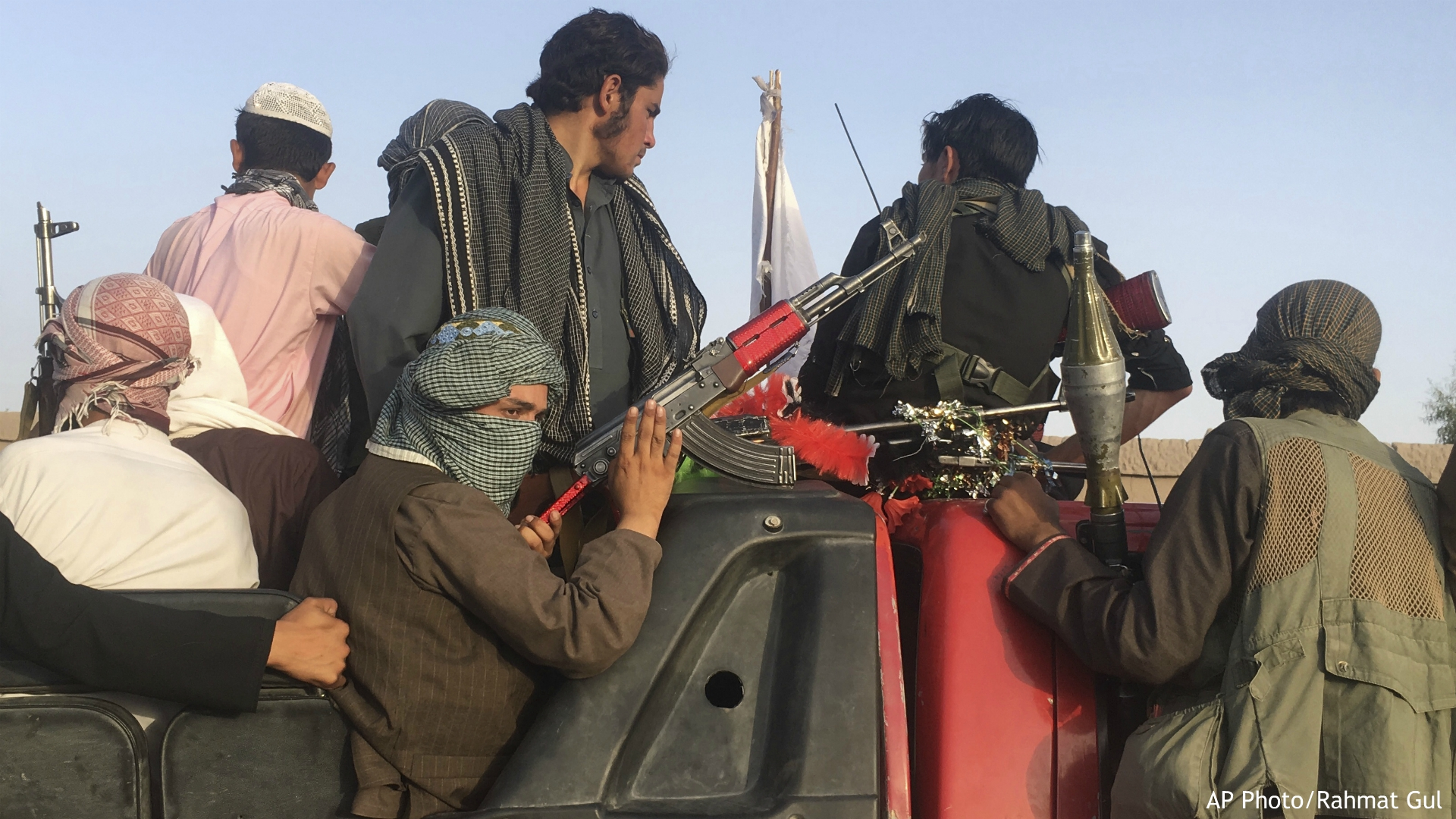 In this June 16, 2018 photo, Taliban fighters ride in their vehicle in Surkhroad district of Nangarhar province, east of Kabul, Afghanistan. Many Afghans view Saturday's expected signing of a U.S.-Taliban peace deal with a heavy dose of well-earned skepticism. They've spent decades living in a country at war -- some their whole lives — and wonder if they can ever reach a state of peace. (AP Photo/Rahmat Gul, file)