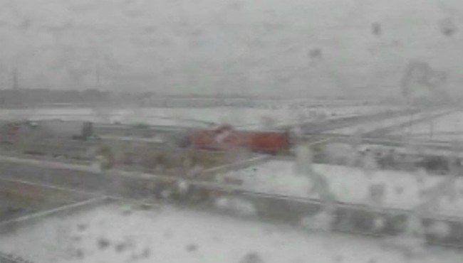 A screenshot of a MDOT camera showing a crash on westbound M-6 at US-131 in Kent County Thursday, Feb. 13, 2020. (Michigan Department of Transportation)