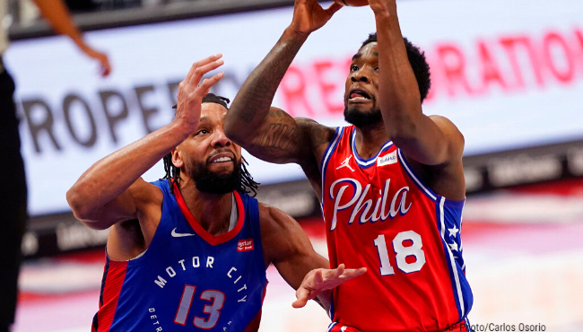 Philadelphia 76ers guard Shake Milton (18) goes up for a layup as Detroit Pistons center Jahlil Okafor (13) defends during the second half of an NBA basketball game, Saturday, Jan. 23, 2021, in Detroit. (AP Photo/Carlos Osorio)