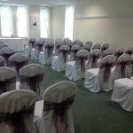 Chair covers and aubergine sash