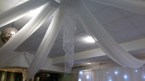 Chandelier and ceiling drapes
