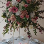 Wild summer style floral display on stands