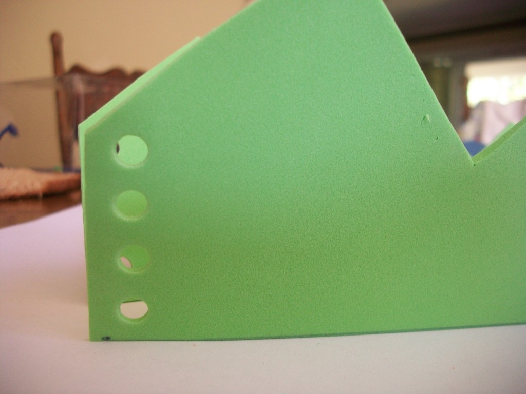 Use The Hole Punch To Make Holes Through Both Layers On