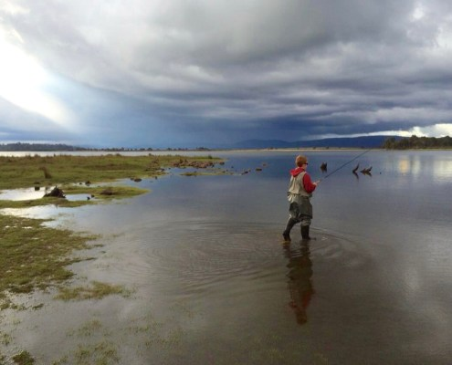 My twelve year old strides into a storm in pursuit of a fish. Bronte Lagoon Tasmania.