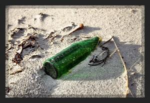 One Green Bottle, lying on the shore