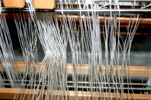 Warp threaded through the eyes on the heddles - looking from the front