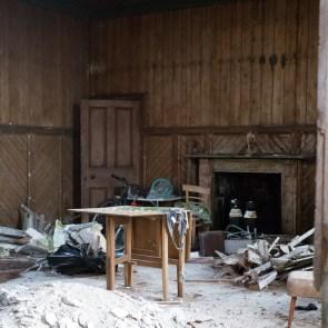 Inside Scar House, through broken window