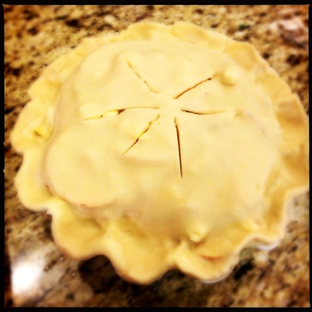 Apple pie with crust, ready for the oven