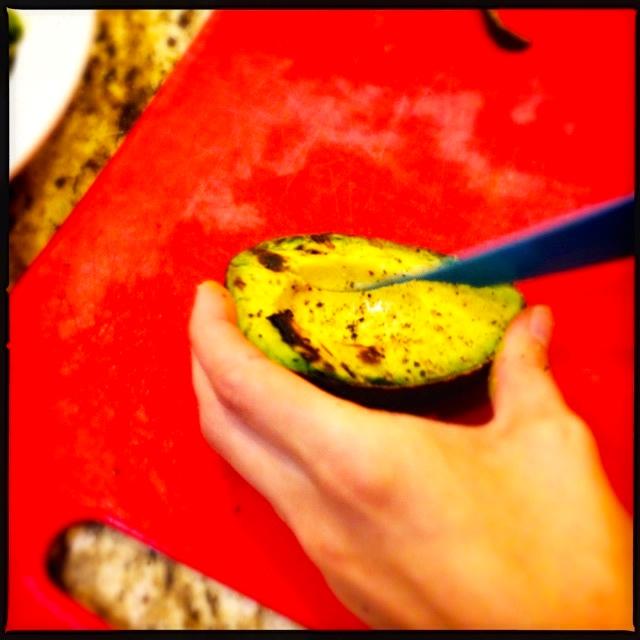 Slicing grilled avocados