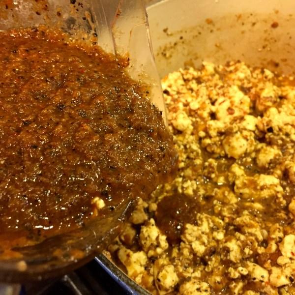 Adding the Sofritas sauce to the braised tofu