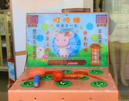 Whac-A-Mole_in_China_01