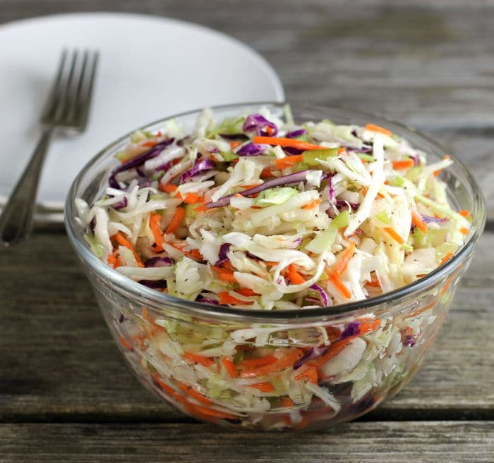 Vinegar based coleslaw is easy to make and makes a great side dish that goes with just about any meal.