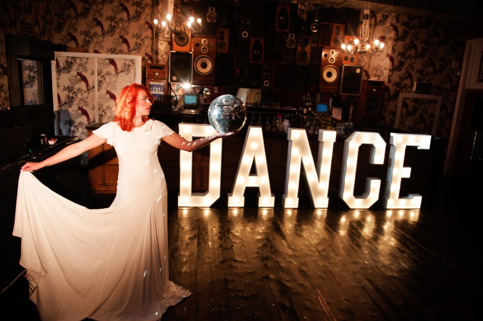 DANCE illuminated letters with dancing bride at The Deaf Institute in Manchester
