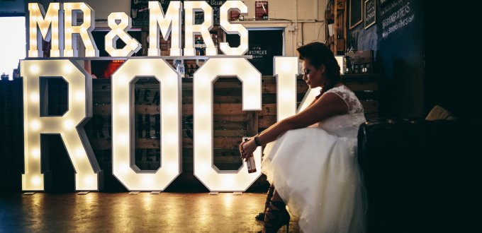 Mr & Mrs ROCK illuminated letters in front of bar at Seven Bro7hers Brewery
