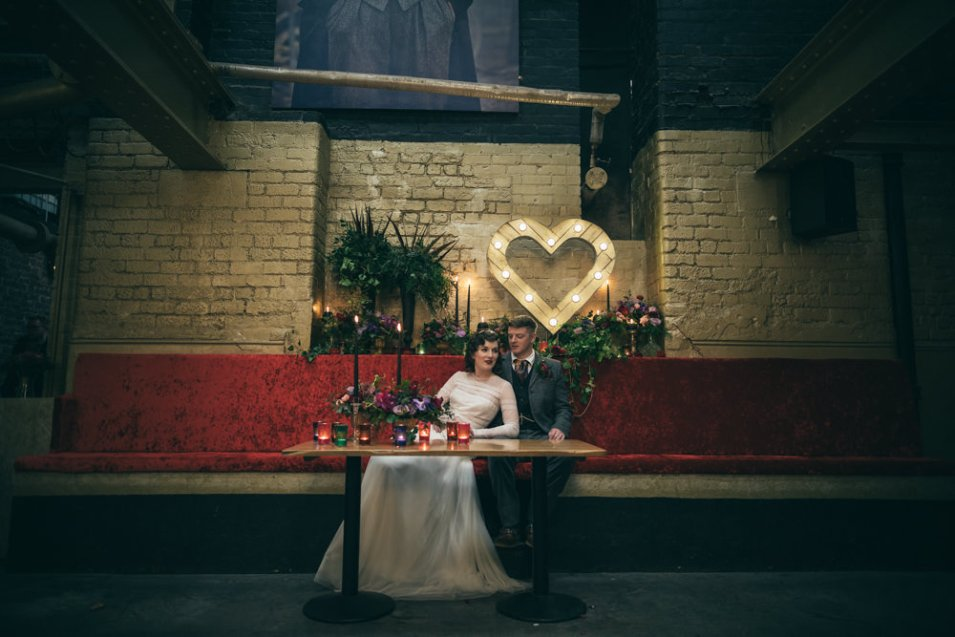 Bride and groom seated with wedding decor