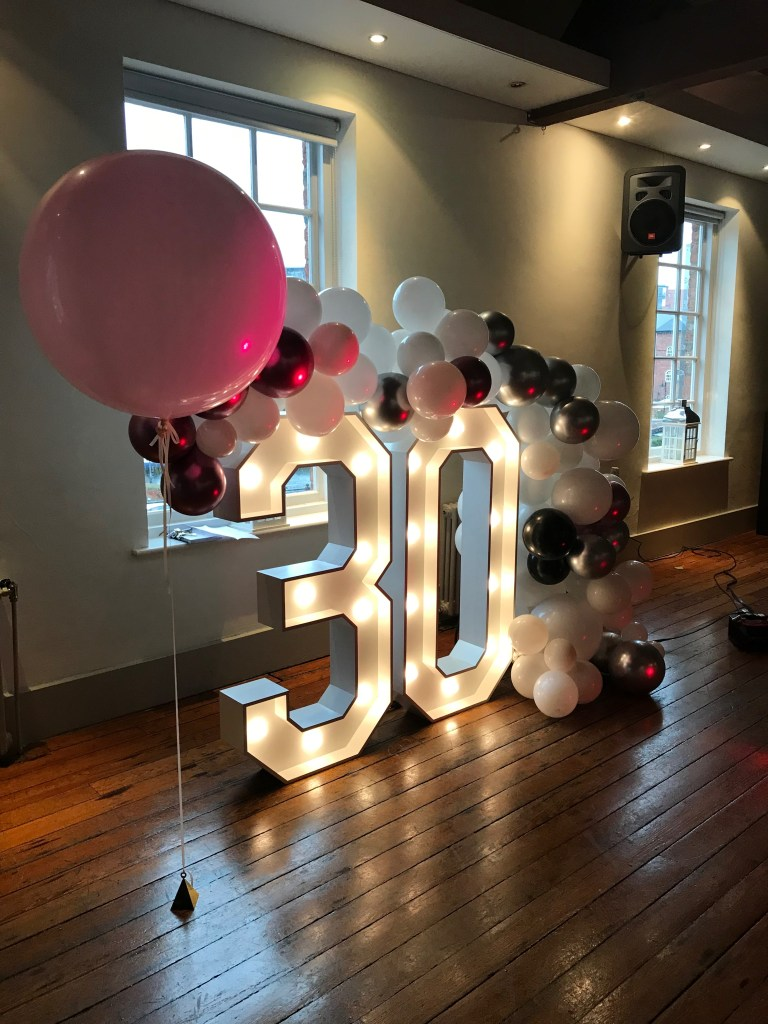 Light up number 30 with balloon garland