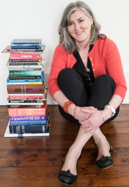 Marian Dougan, with books and dictionaries