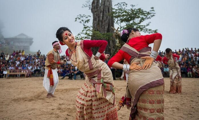 Dancers dancing to celebrate the Bihu festival