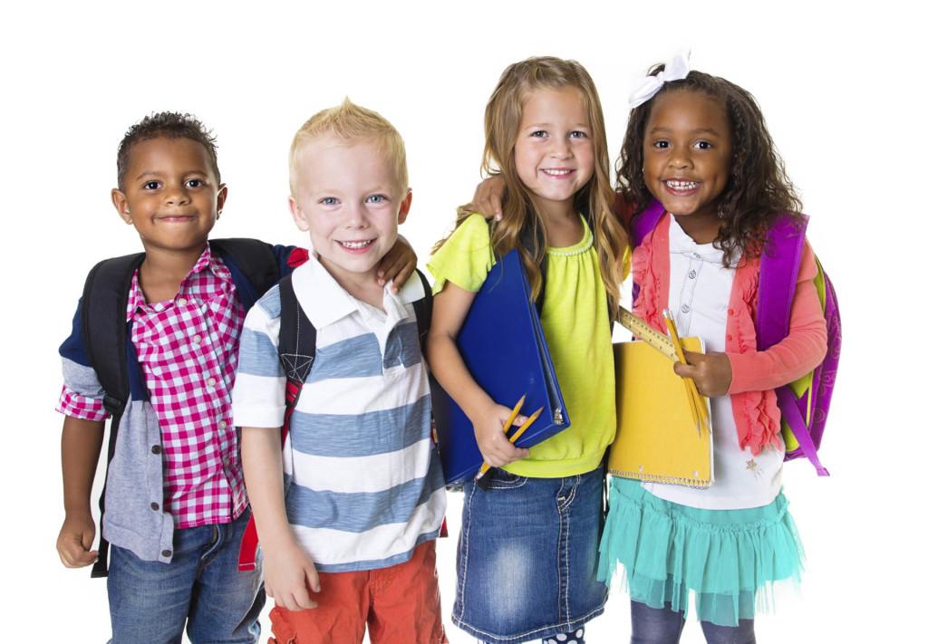 Little school kids going to school