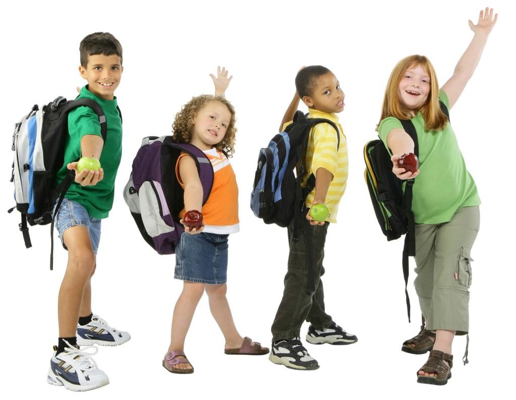 Lovely school kids having apple