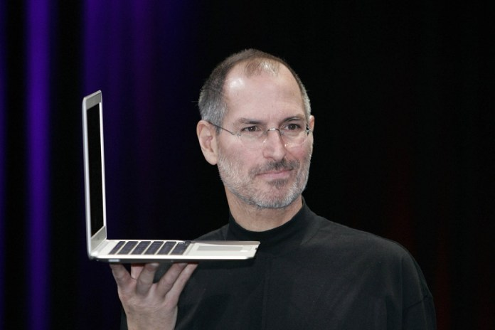Popular businessman Steve Jobs with apple laptop