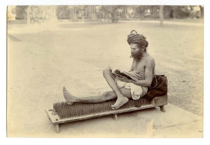 10. Sadhu on a bed of nails (casually reading a book!) - 1880s.