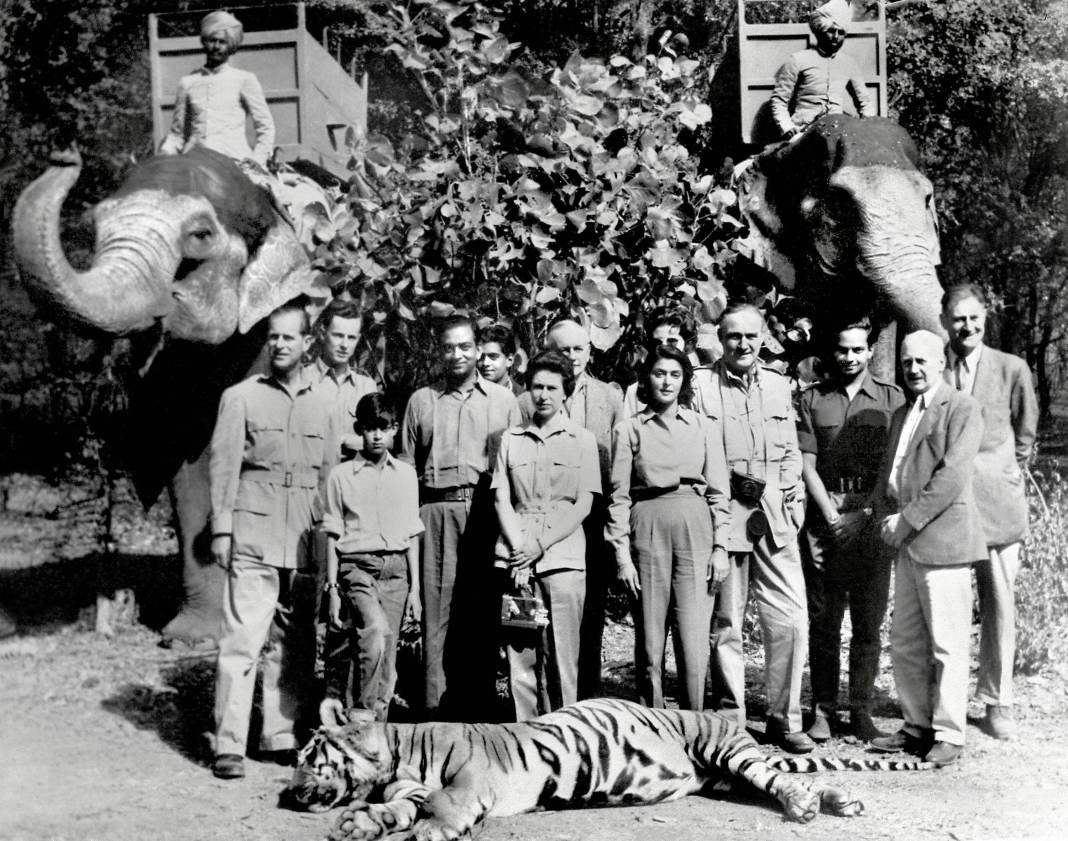 27.Queen Elizabeth and Maharani Gayatri Devi of Jaipur pose after a tiger hunt in India, 1961.