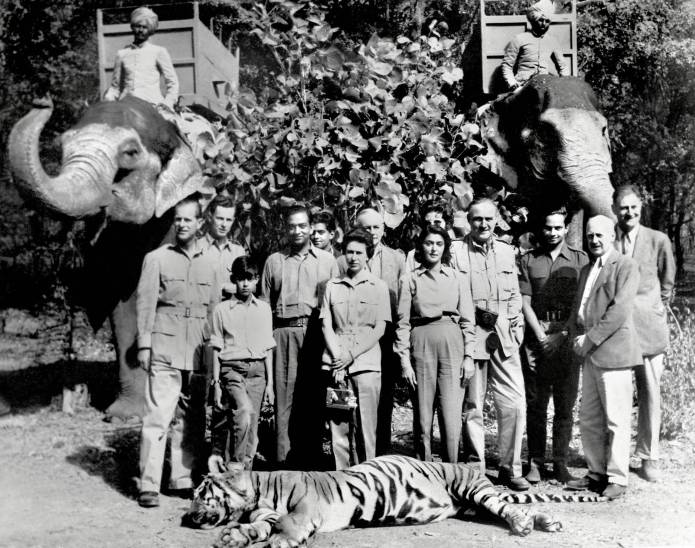 27. Queen Elizabeth and Maharani Gayatri Devi of Jaipur pose after a tiger hunt in India, 1961.