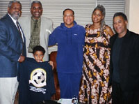 Chris Silvera, Clarence Thomas,<br>Louis Farrakhan, Brenda Stokely,<br>Larry Holmes. Bashiri Silvera in front<br>holding MWM T-shirt. Aug. 27.