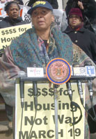 Brenda Stokely in<br />zero degrees in<br />New York City speaks<br />at news conference<br />for Troops Out Now rally.