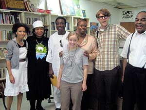 FIST member Rima L'amir, Theresa El-Amin, David Josué, Cynthia McKinney, Dante Strobino and Rev. David Foy at Know Bookstore. In front of McKinney is Green Party member and FIST activist, Elena Everett. Josué is McKinney's staff assistant.