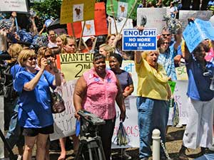 Teachers rally in Raleigh, N.C., against<br>governor's furloughs.