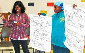 Raleigh Fight Imperialism, Stand Together<br>member Vidya Sankar and Shafeah M'Balia.