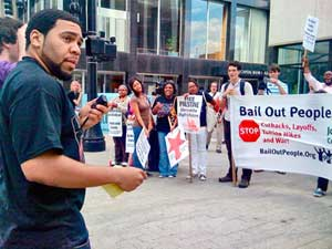 Angaza Mayo-Laughinghouse, of Black<br>Workers for Justice Youth and a student at<br>UNC-Greensboro, speaks in downtown<br>Raleigh, N.C.