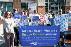 <blockquote>Mental health workers rally at the office of Adminstrative Hearings in Raleigh Sept. 20 when Judge Beecher Gray ruled five Black workers were fired unfairly. Pictured from right, UE150 members Cornell Hendrick (Central Regional Hospital), Ernestine Smythe (CRH), dorothy Williams (CRH), Suzanne Bailey (CRH), Bernell Terry (CRH), Ben Carroll (UNC) and community supporters Brigid Flaherty (Pushback Network), Ajamu Dillahunt (NC Justice Center) and Dani Martinez-Moore (NC Justice Center).</blockquote>