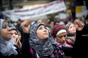 Egyptians demonstrate against President Morsi demanding that he withdraw decrees that usurp powers from the judiciary.