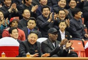 Kim Jong Un and Dennis Rodman watch an exhibition basketball game at an arena in Pyongyang.