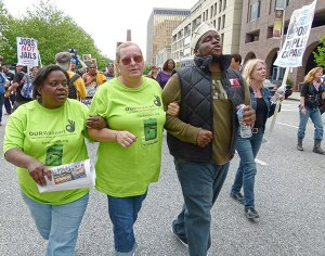 OUR Walmart organizers Barbara Elliott and Cindy Murray join Baltimore activists Rev. C.D. Witherspoon and Sharon Black on People's Power March, May 11.
