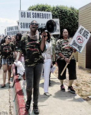 Rashida Hameed leads march in San Diego, June 29.WW photo: Gloria Verdieu
