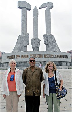 WWP delegation, Deirdre Griswold, Larry Holmes, Elena Gilbert, at the Workers' Party of Korea monument.