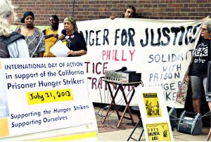 Pam Africa speaks at a rally in front of the Philadelphia Federal Building on July 31, in solidarity with the California prisoners' hunger strike.