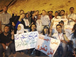 Anti-war delegation from U.S. meet with Syrian youth at their 'Over Our Dead Bodies' encampment on Mount Qasioun outside Damascus These youth have pledged to resist any imperialist attack on Syria. U.S. delegates are Ramsey Clark, Cynthia McKinney, John Parker, Sara Flounders, Dedon Kamathi and Johnny Achi.