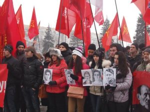 Young communists in Kiev carry photos of Komsomol resistance fighters executed by Nazis in occupied Ukraine 71 years before, on Feb. 8, 1943.