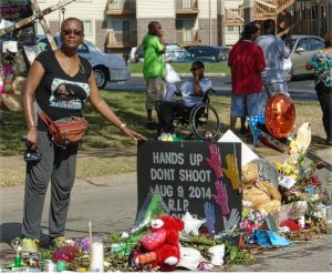 Monica Moorehead at memorial marking where Michael Brown died.WW photo: Lal Roohk